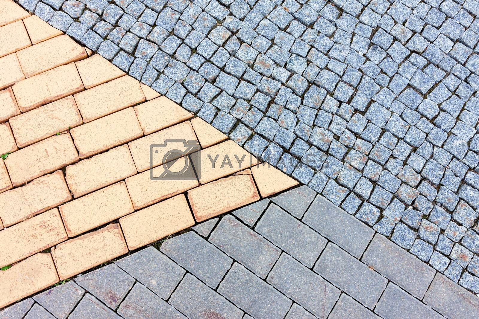 Three different cobble stone textures connected as natural paving background