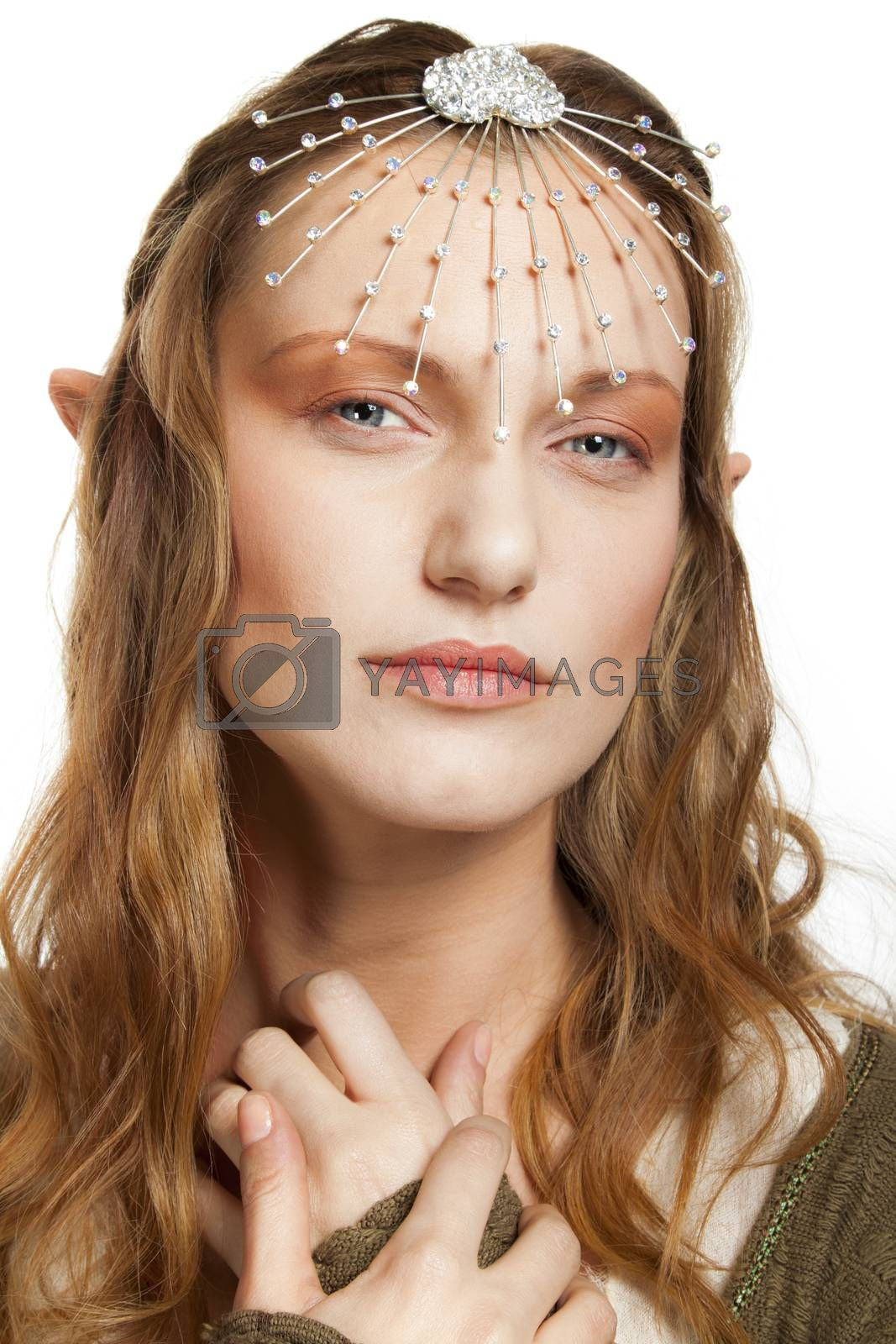 A portrait of a beautiful woman with tiara and elfs ears, looking at camera.