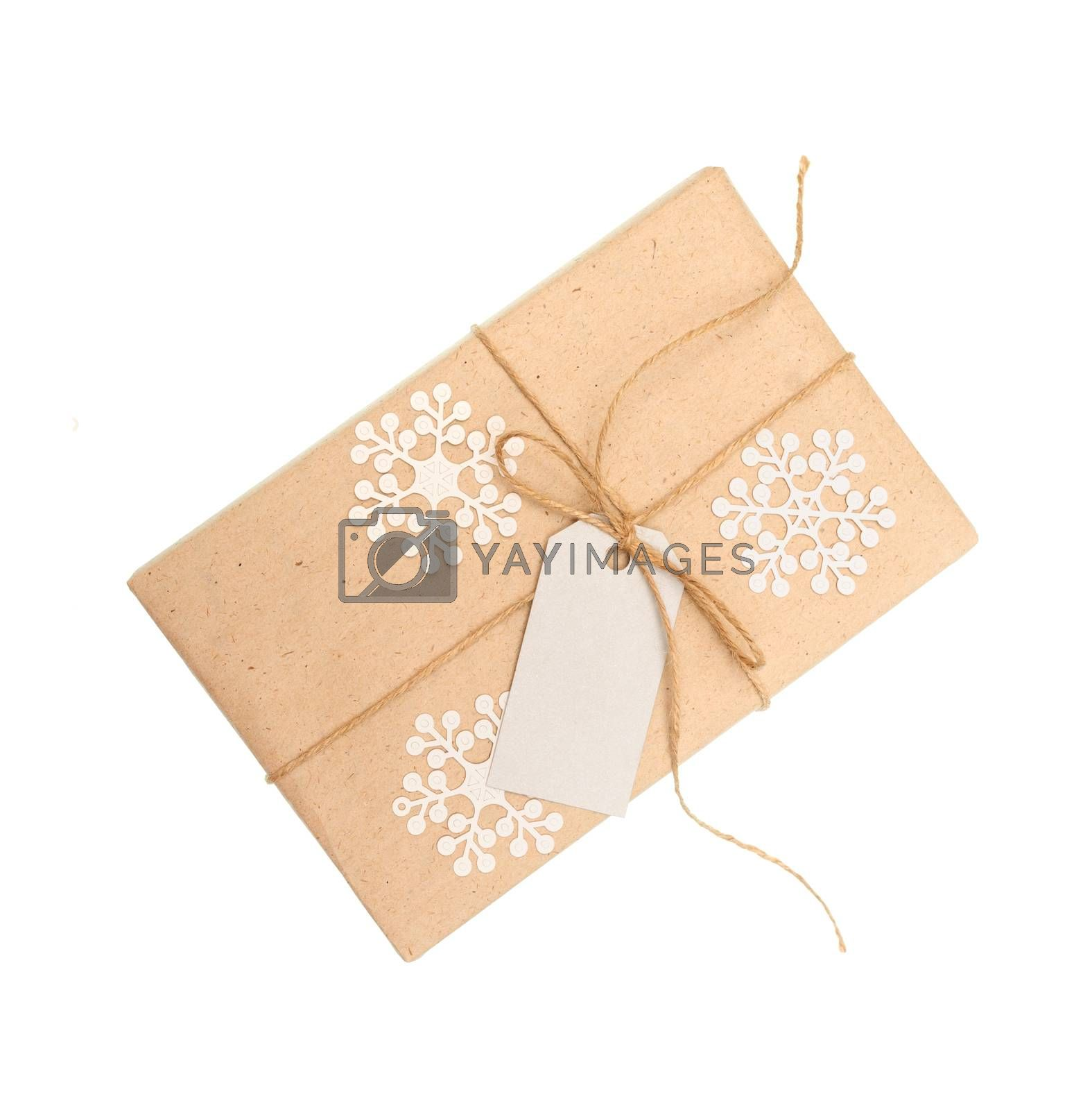 gift box of kraft paper with a tag for text on a white background.