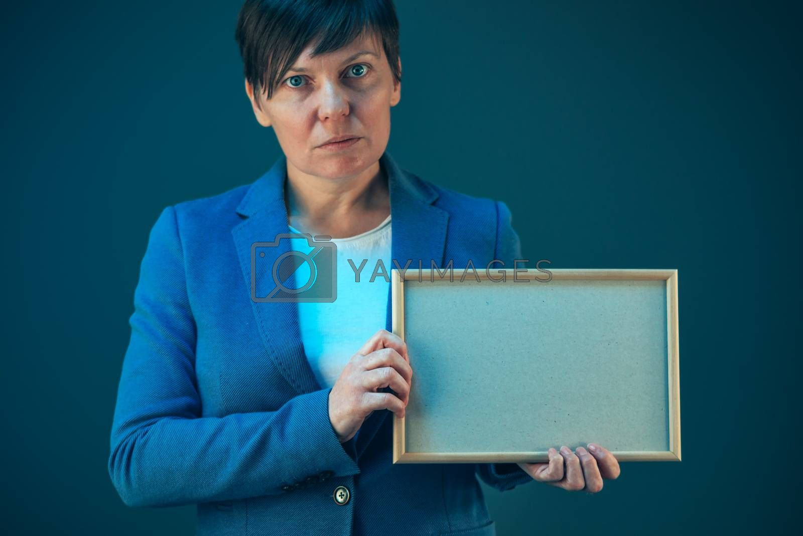 Business woman holding blank diploma certificate as mock up copy space
