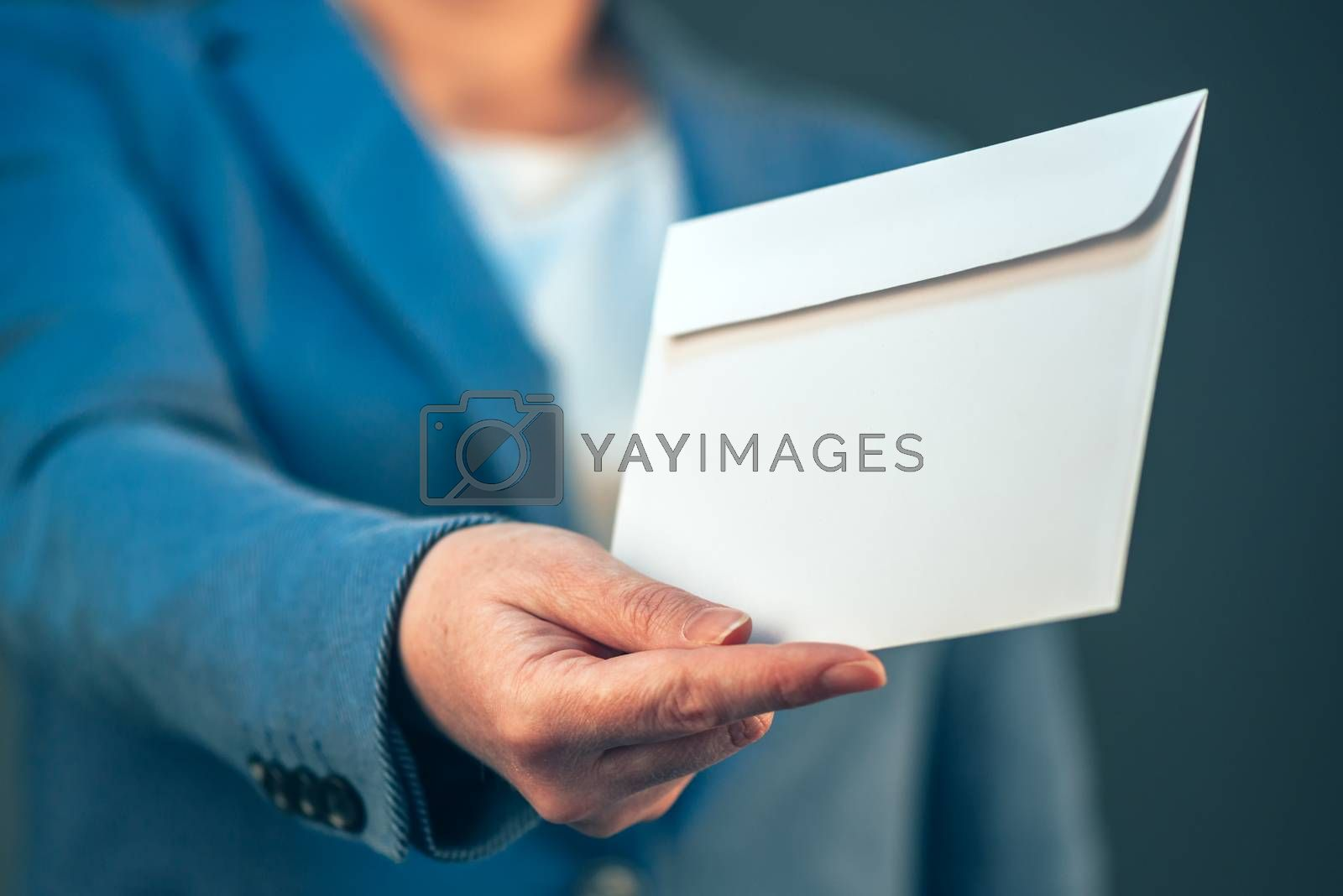 Businesswoman offering white envelope as bribe, concept of corruption in business activity