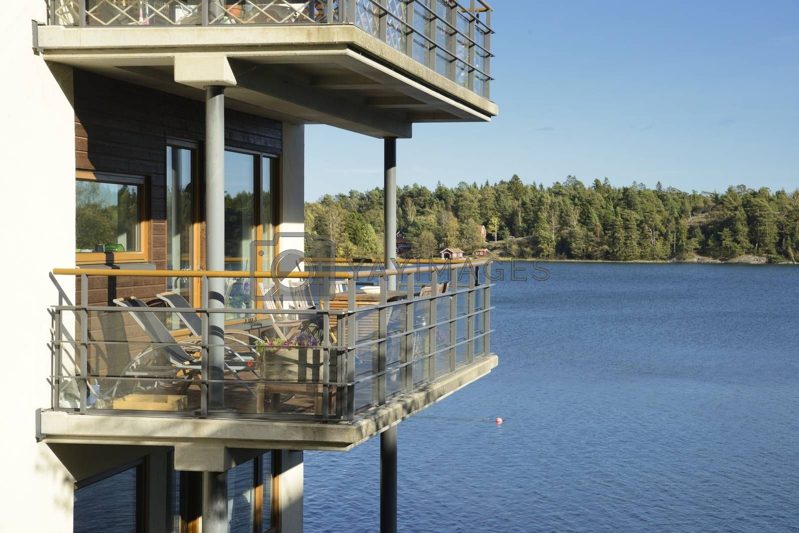 Balconies on the side of a building with lake view.