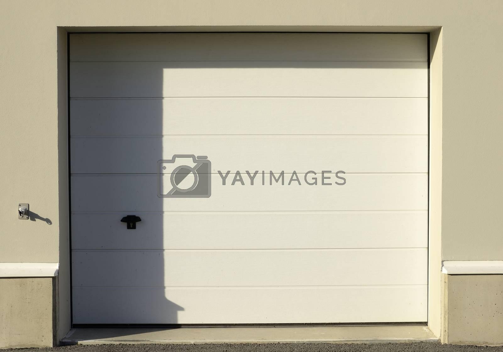 Garage door, half in shadow, half in sunshine.