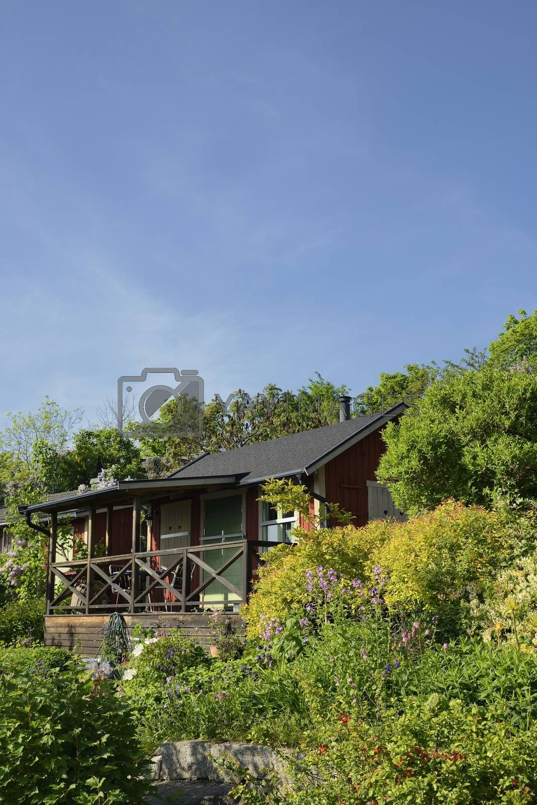 Idyllic cottage in botanical garden.