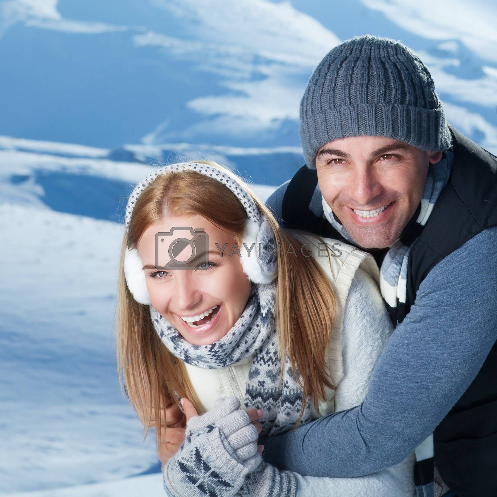 Closeup portrait of cheerful smiling couple playing with each other in the winter park, having fun in the mountains, happy wintertime holidays