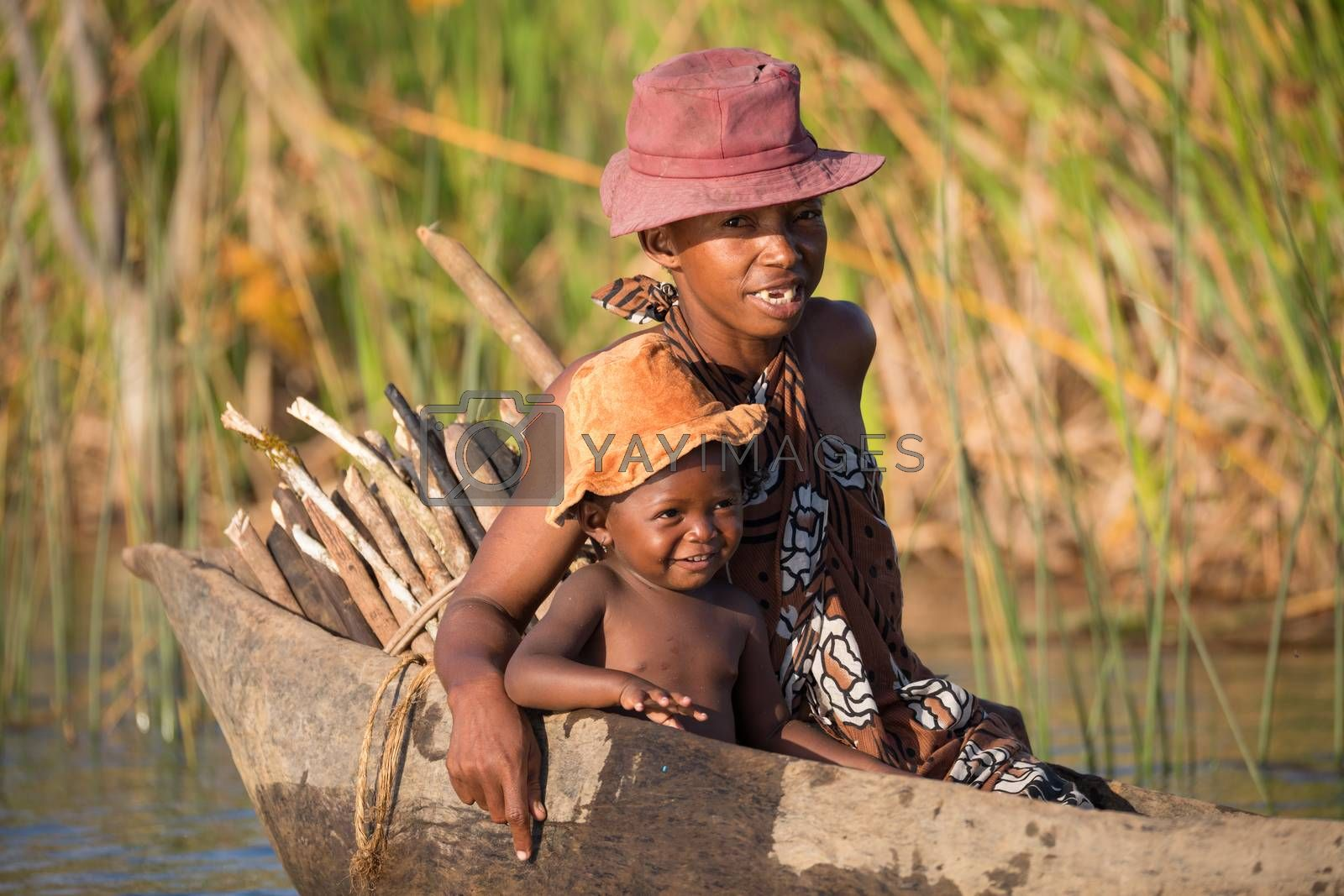 MADAGASCAR OCTOBER 18.2016 Malagasy countryside people from village transport freight by Traditional handmade dugout wooden boat. Everyday life on the river. Maroantsetra October 18. 2016, Madagascar.