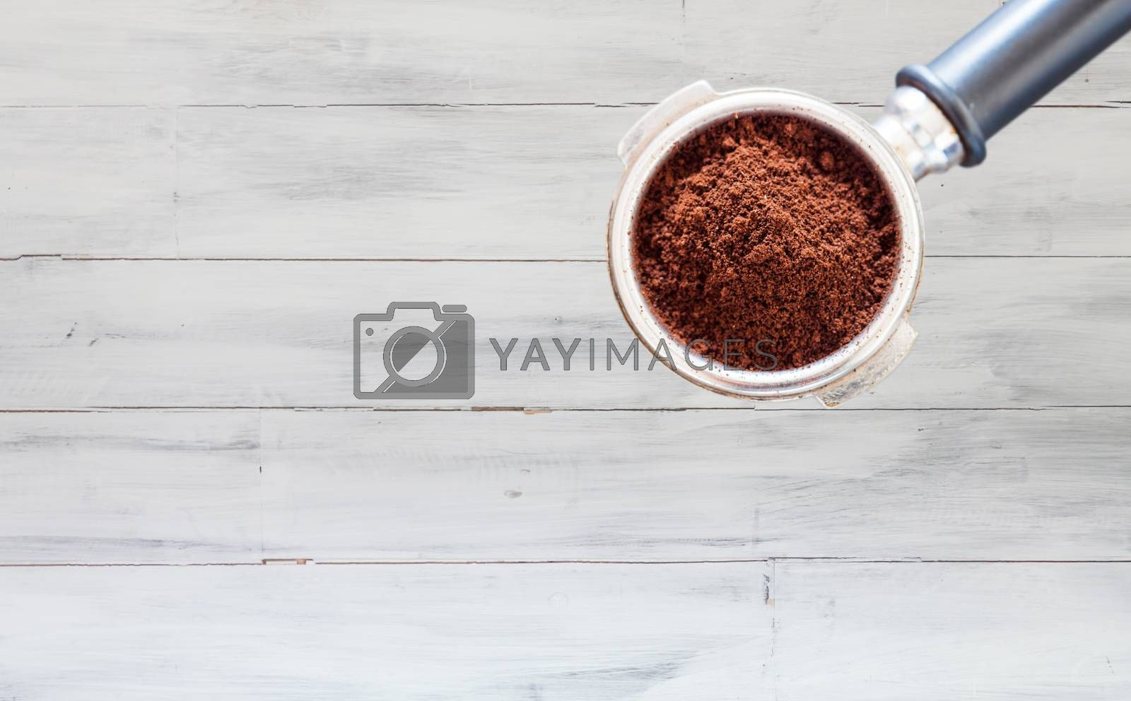Coffee grind in group on white wooden wall texture background