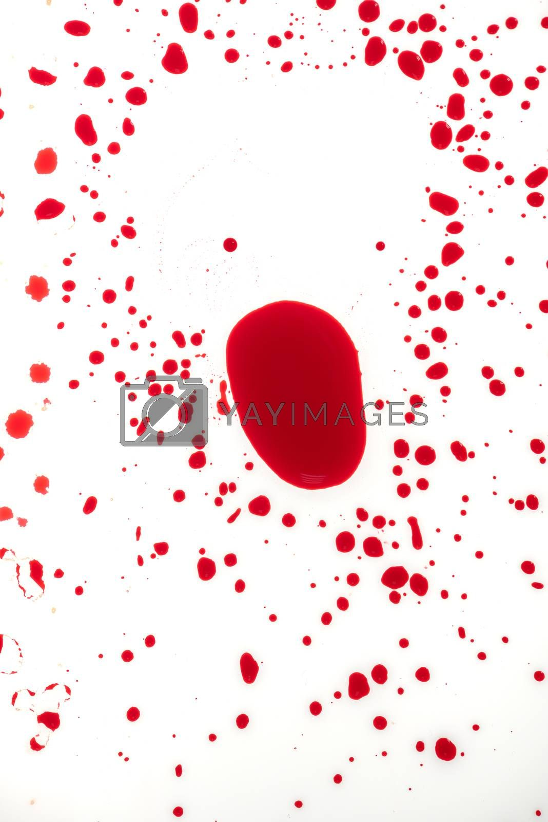 Blood drips on white surface, abstract background for violence, murder or crime scene