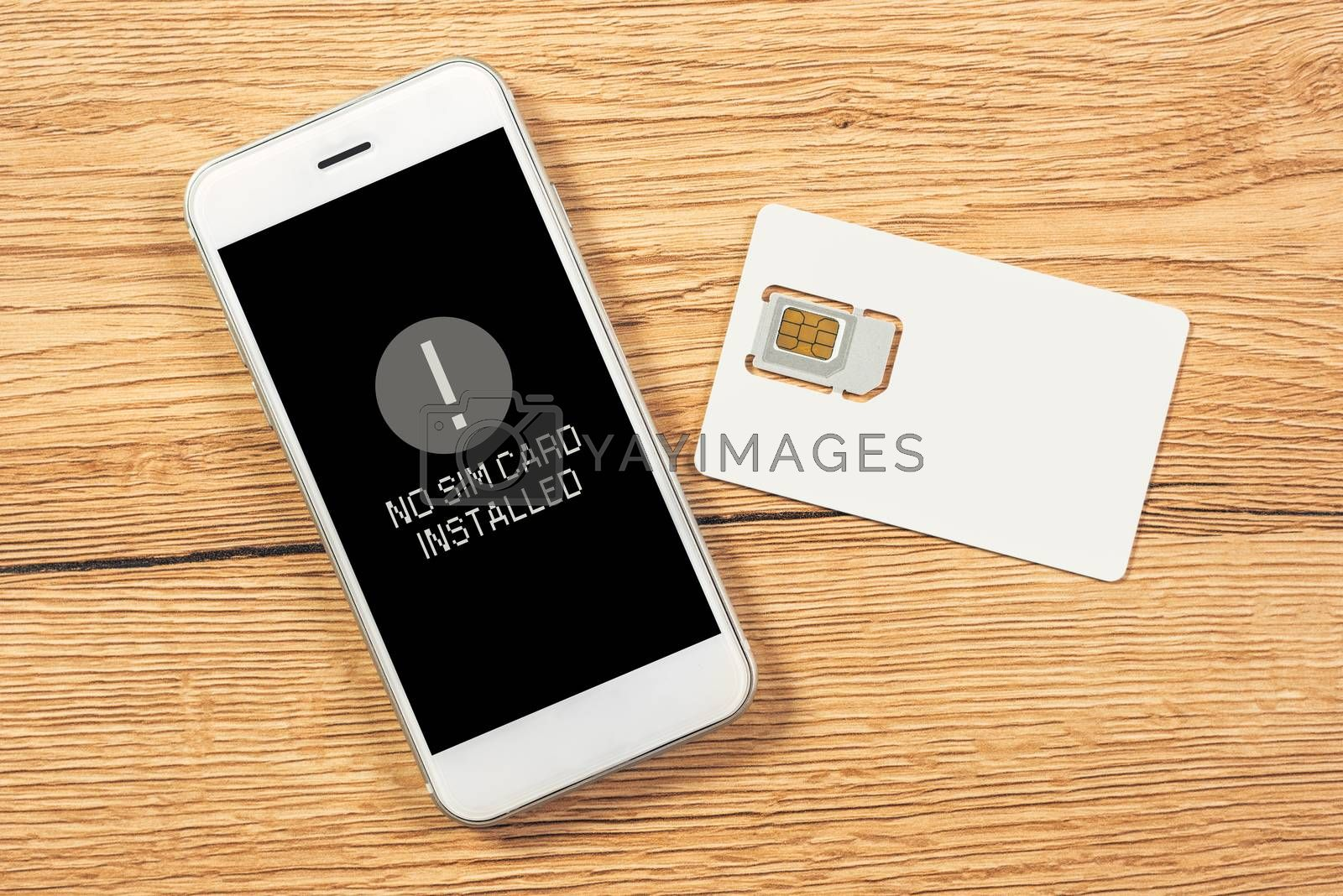 No SIM card installed notification on smartphone screen, top view mock up for telecommunication provider microchip with mobile phone on office desktop