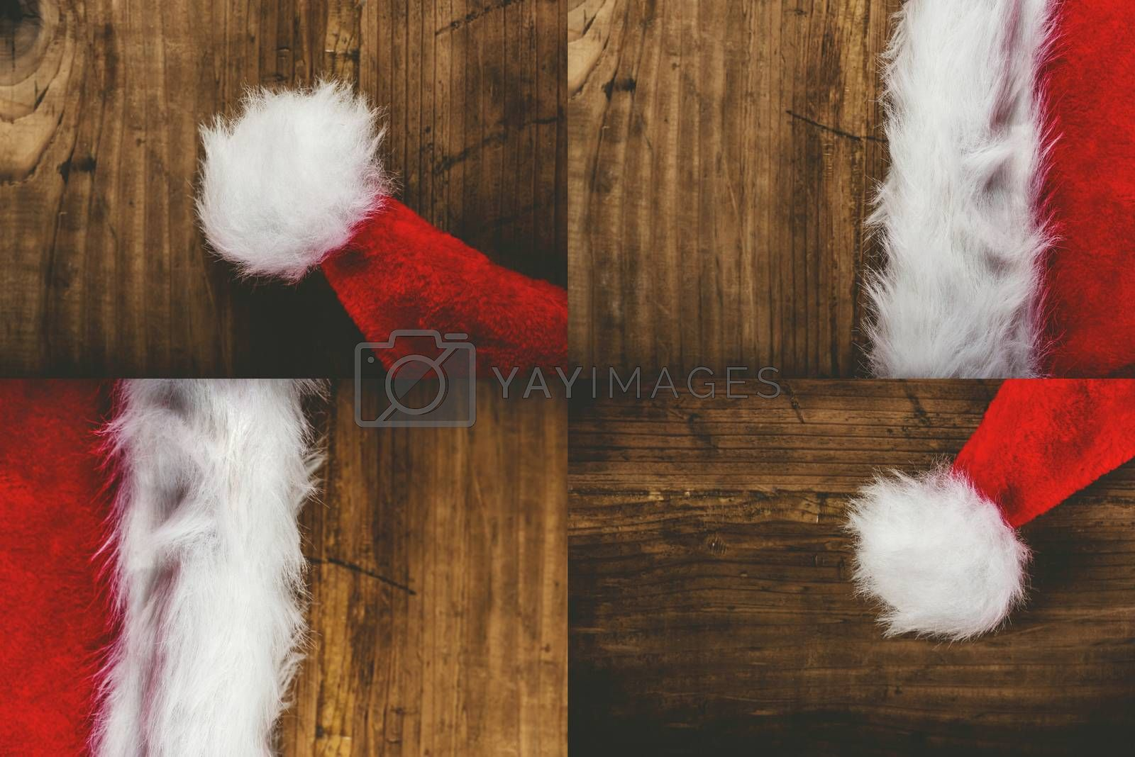 Santa Claus hat on wooden desk, top view