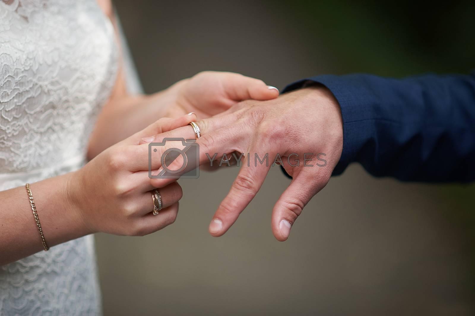 bride dress ring for groom on wedding ceremony.