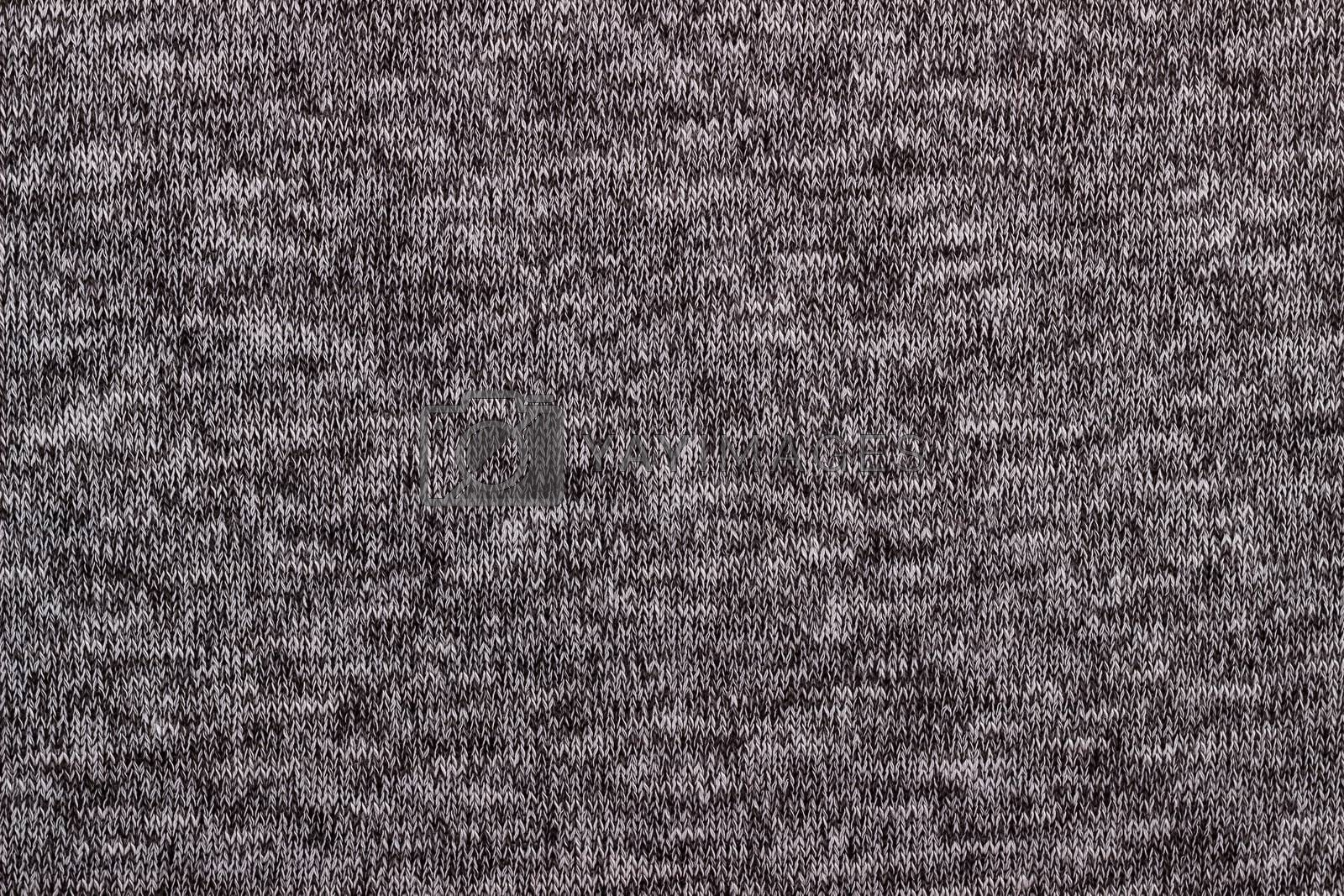 Texture of gray knitted woolen fabric for wallpaper and an abstract background