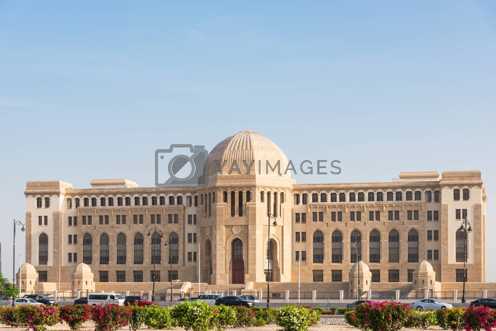 The Supreme Court of Oman in Muscat, The Sultanate of Oman. Cars in the foreground are blurred due to motion.