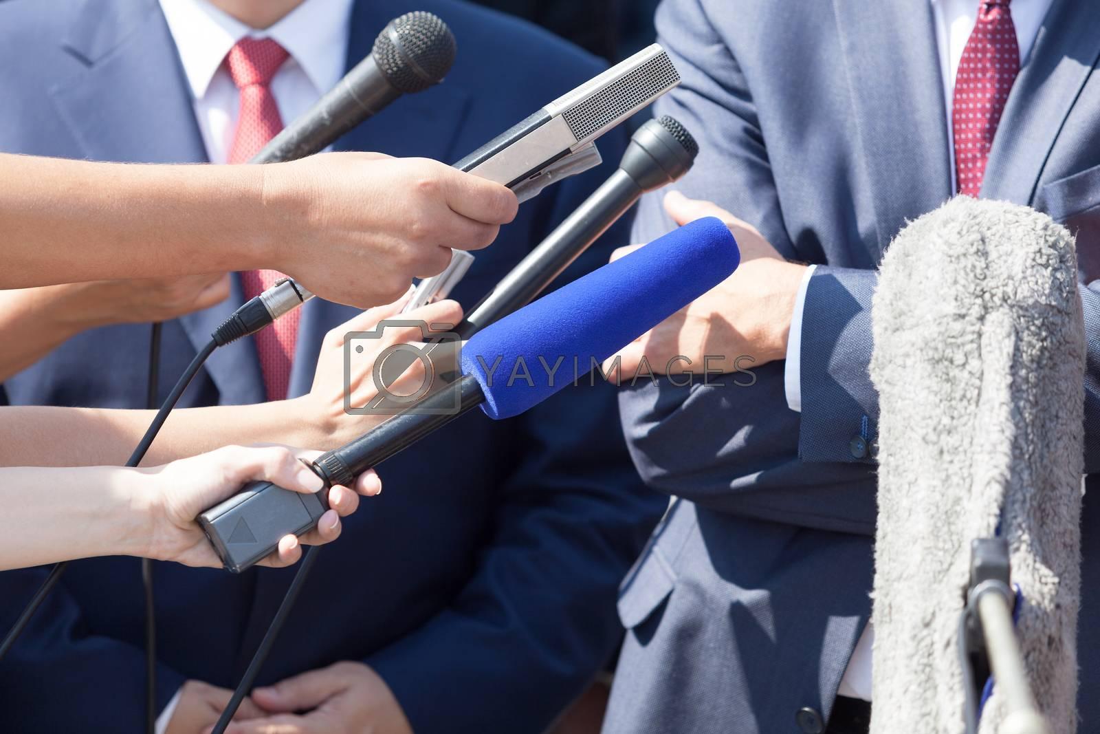 Media interview with businessperson, politician or spokesman