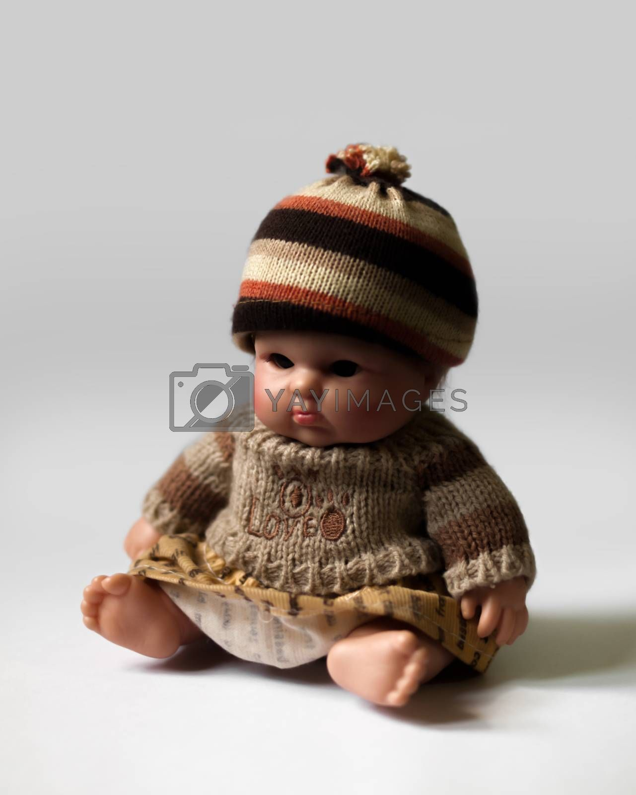 COLOR PHOTO OF SITTING DOLL