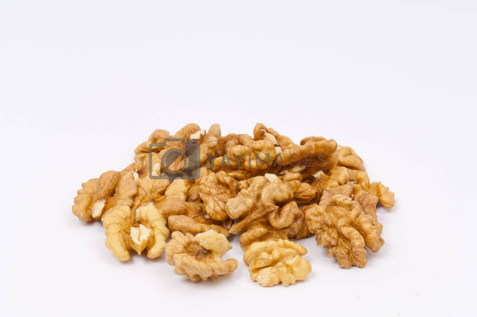 Pile of walnuts on white background by horizonphoto