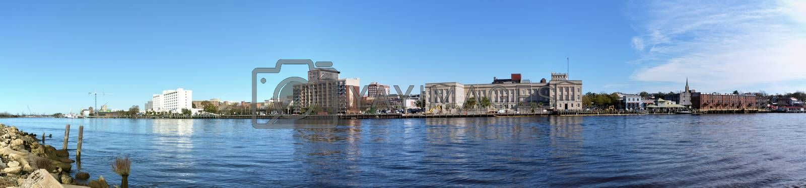 A view of Wilmington North Carolina from across the Cape Fear River. The photo is a panoramic shot.
