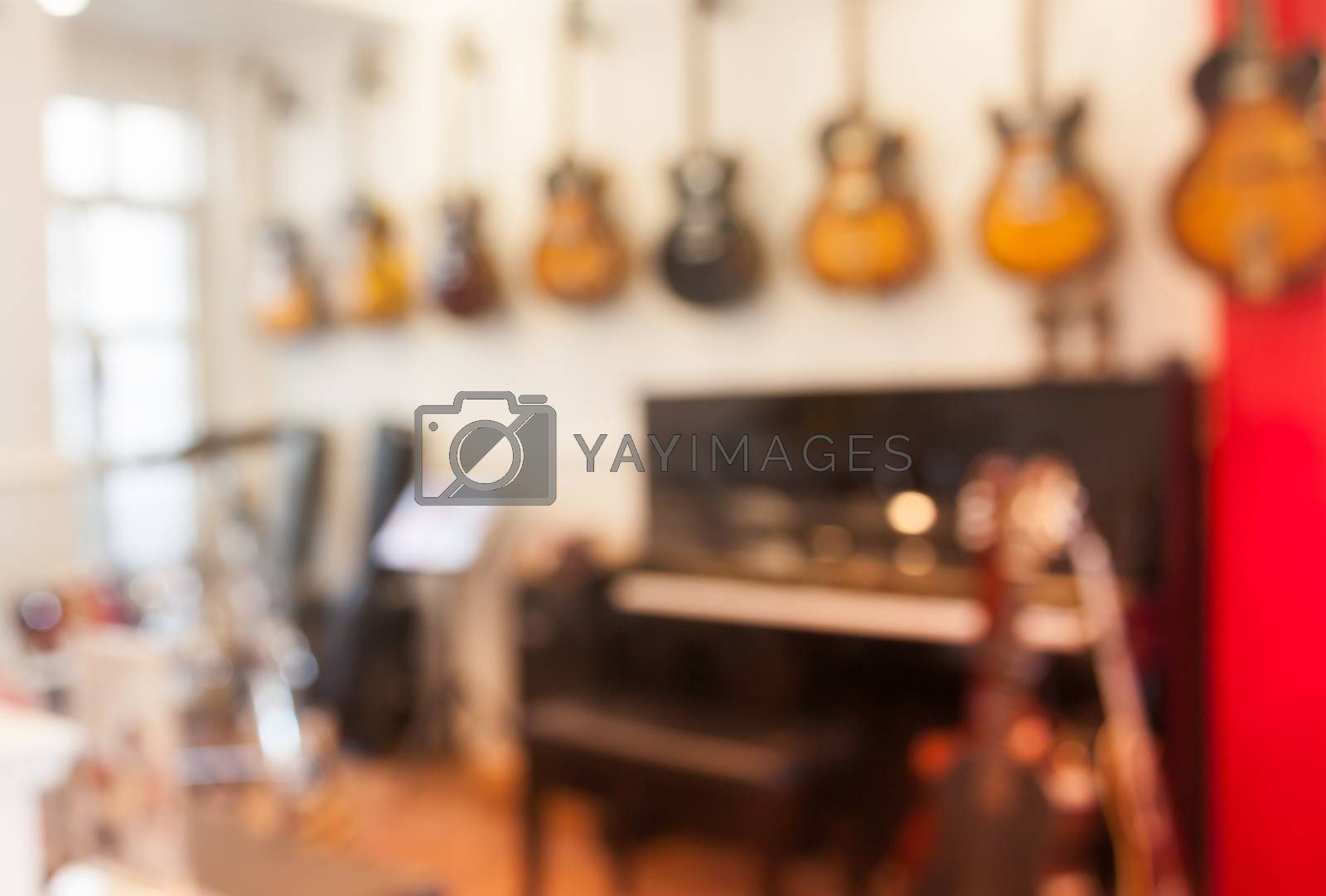 Blur abstract background with instrumentsin music store by punsayaporn