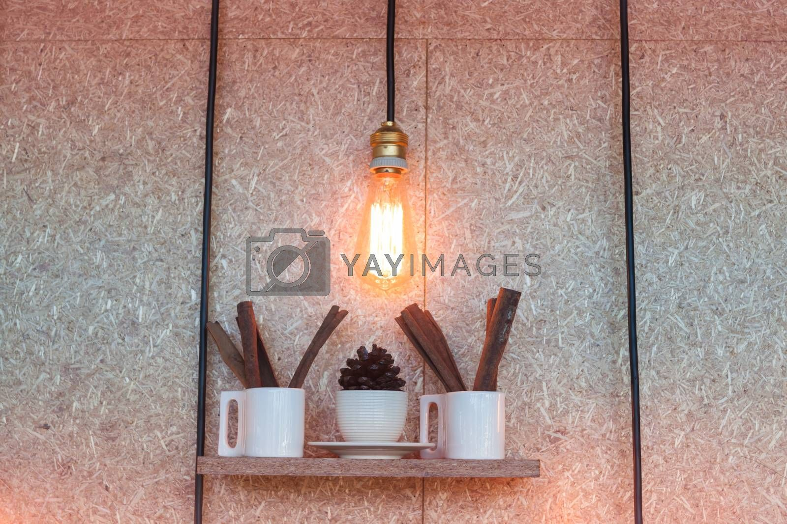 Vintage lighting decorated on brown background by punsayaporn