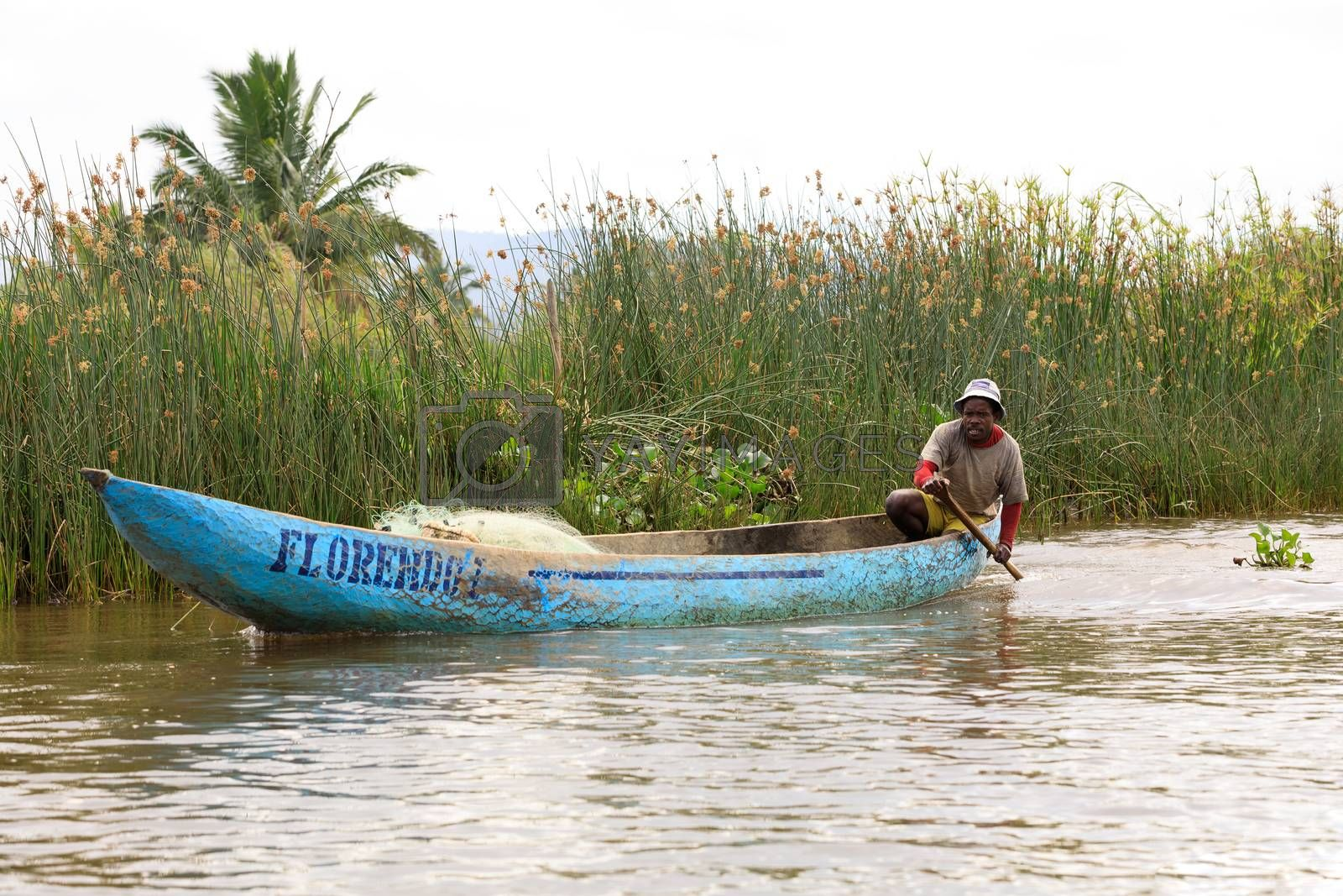 MADAGASCAR OCTOBER 19.2016 Malagasy countryside people from village transport freight by Traditional handmade dugout wooden boat. Everyday life on the river. Maroantsetra October 19. 2016, Madagascar.