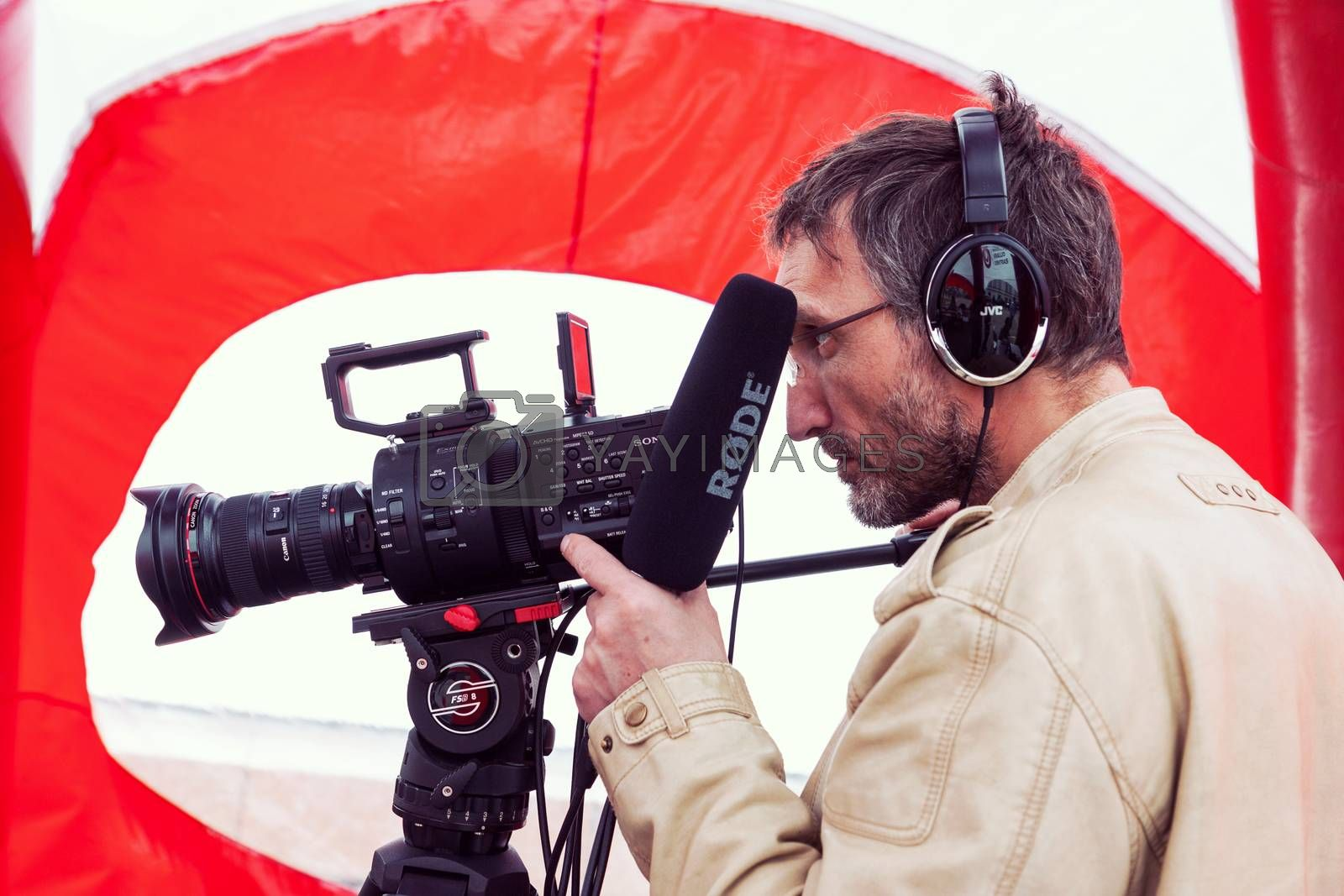 VILNIUS, LITHUANIA - MAY 21, 2016: Closeup of cameraman shooting event on the street in Vilnius, Lithuania