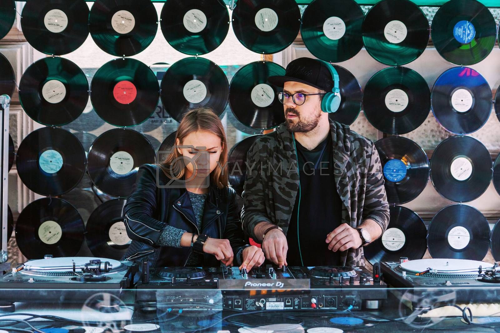 VILNIUS, LITHUANIA - MAY 21, 2016: Pair of young DJ mixing music on the street in Vilnius, Lithuania
