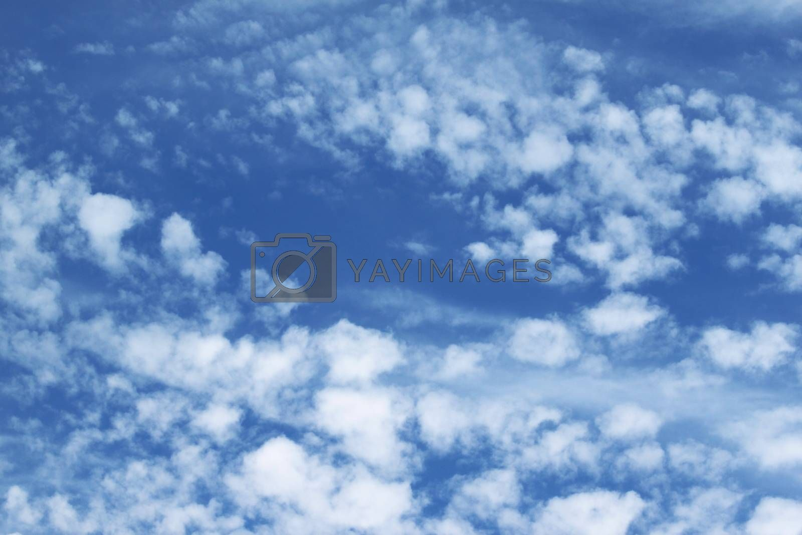 Beautiful blue and white sky with clouds in it.