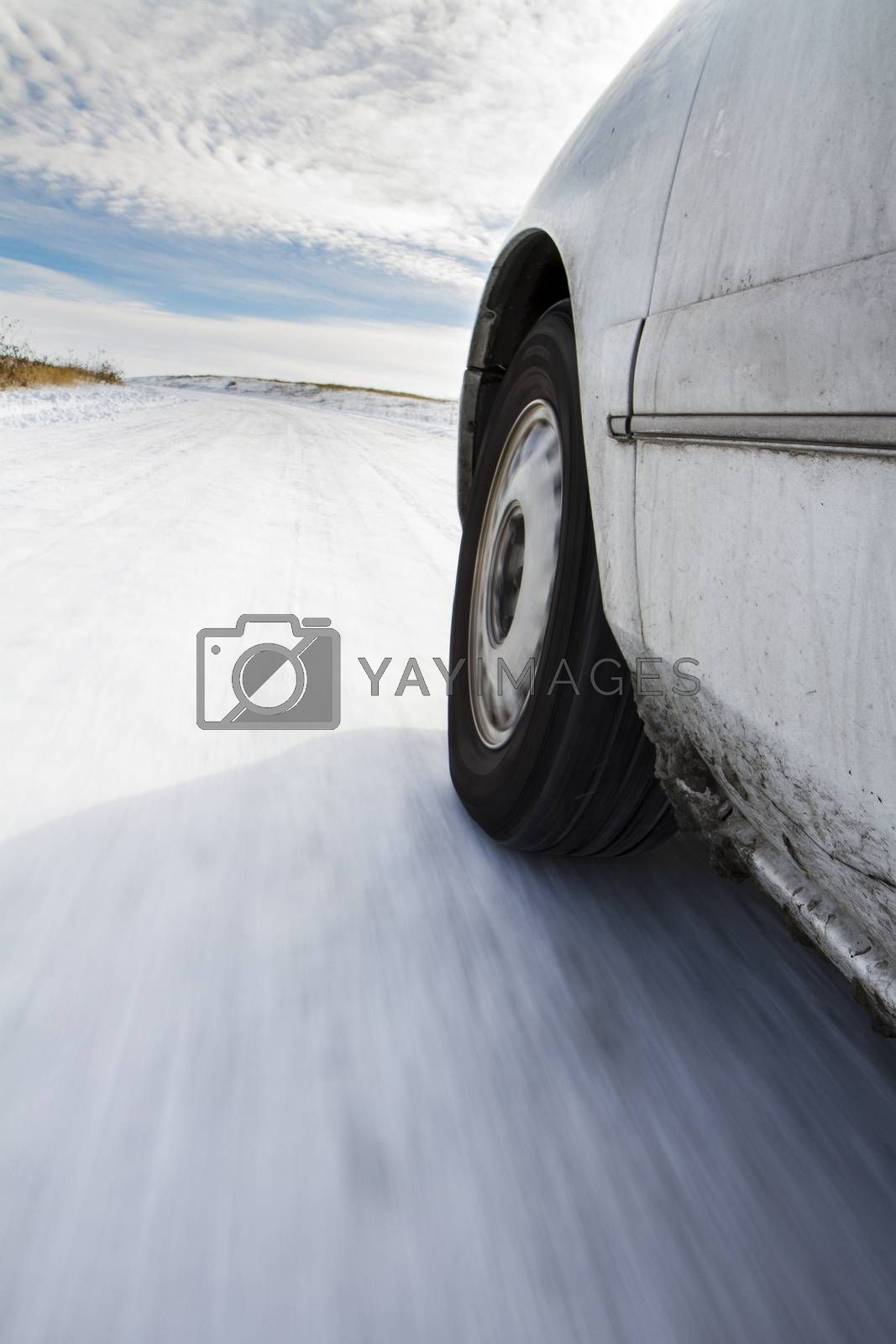 Car driving down the road in the winter snow