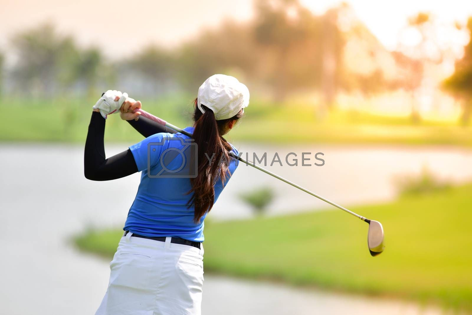 Golfer hitting golf shot on summer vacation, concept go to success.