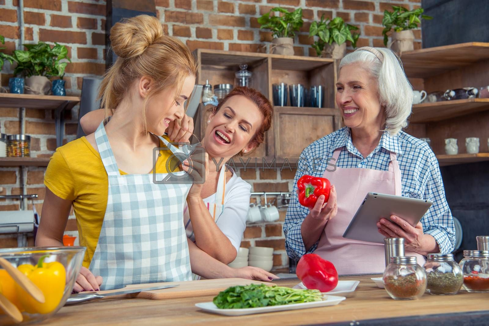 Smiling family cooking together in kitchen
