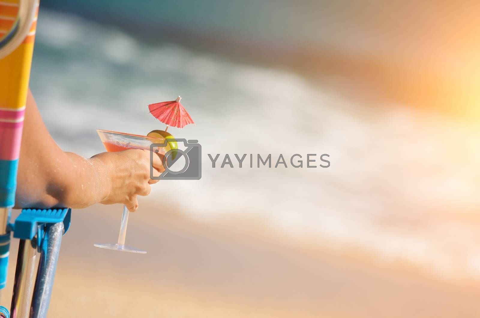 Woman Relaxing on Beach with Tropical Drink.