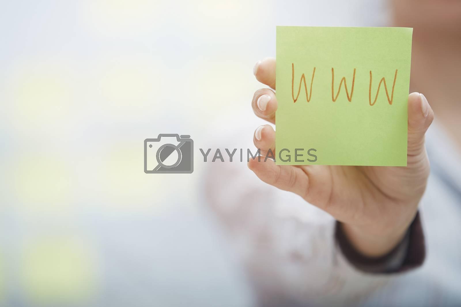 Woman holding sticky note with Internet address
