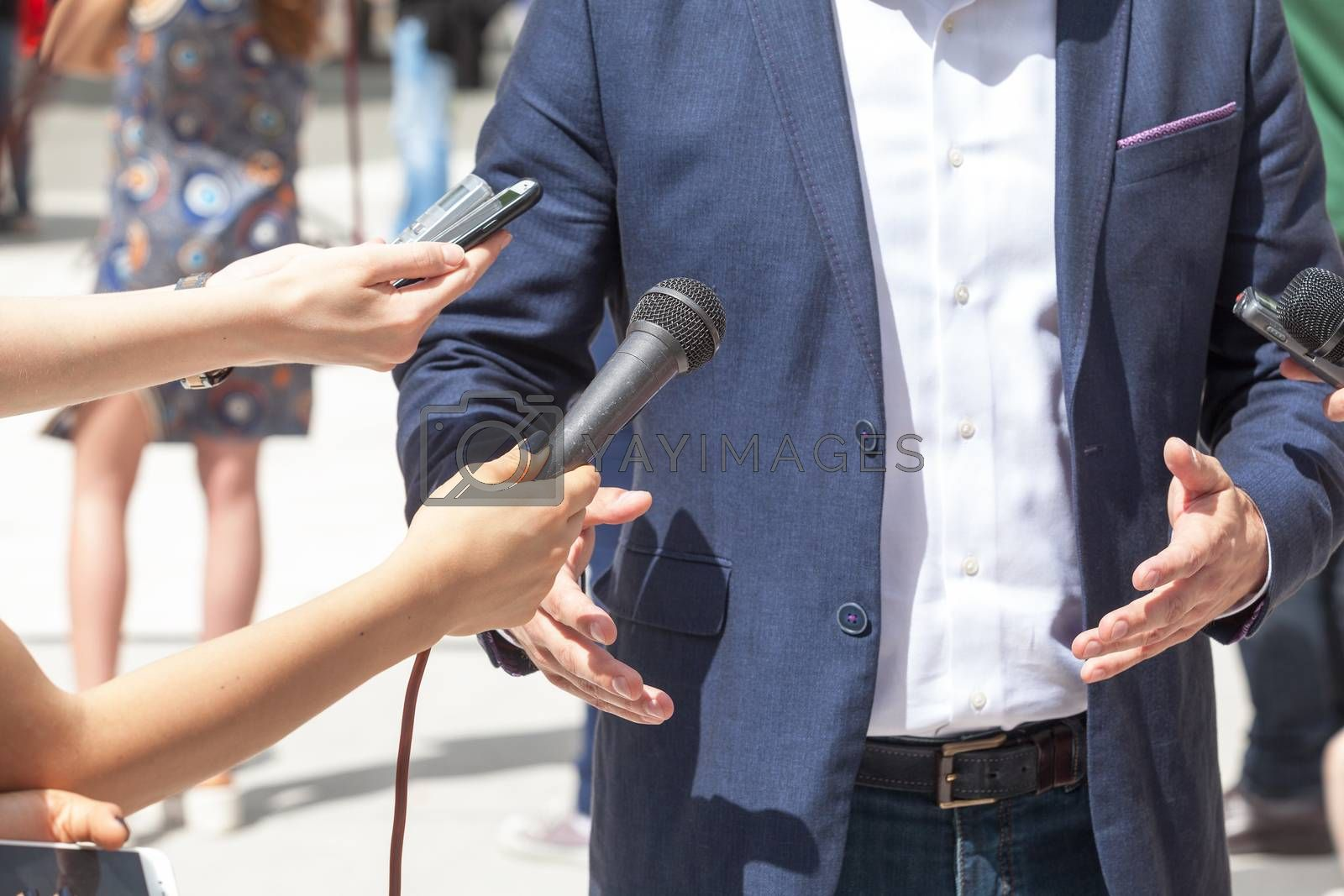Reporters making interview with businessman or politician