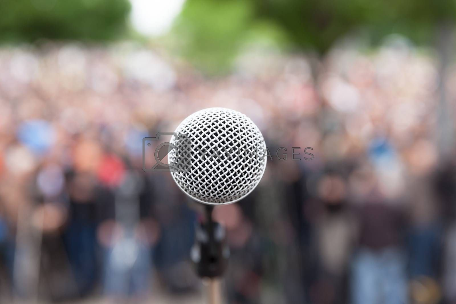 Political protest. Public demonstration. Microphone.