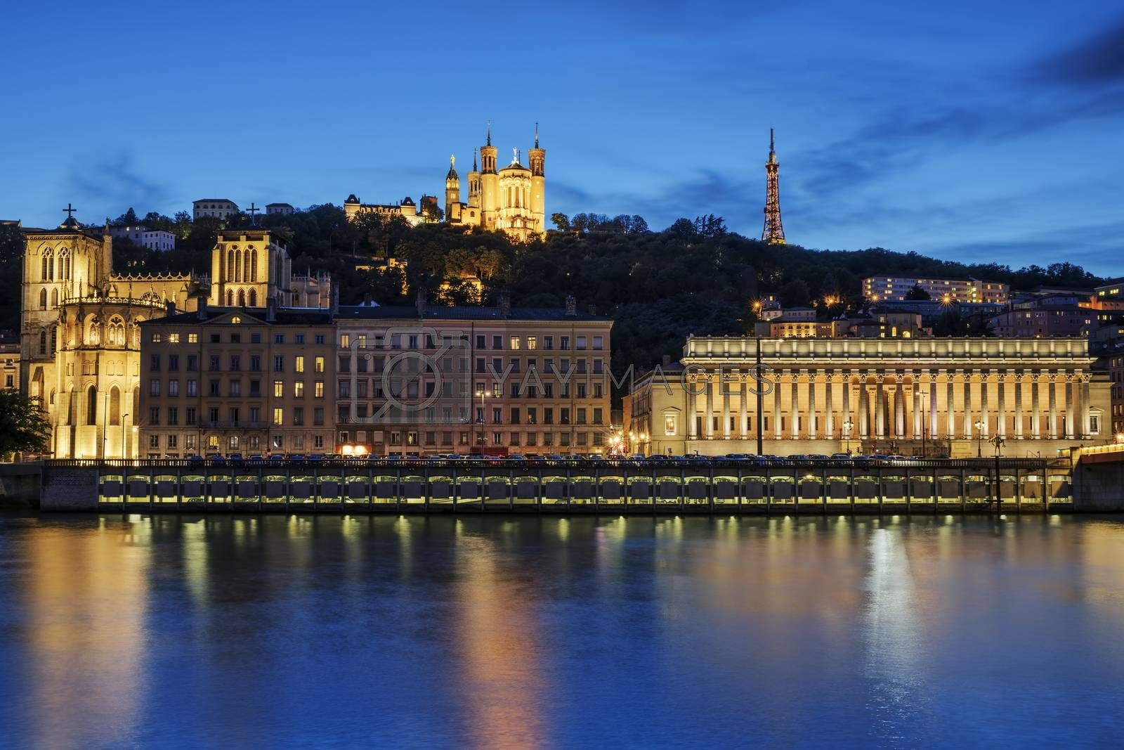 Night view over the Saone river to the Fourviere cathedral in Lyon city.