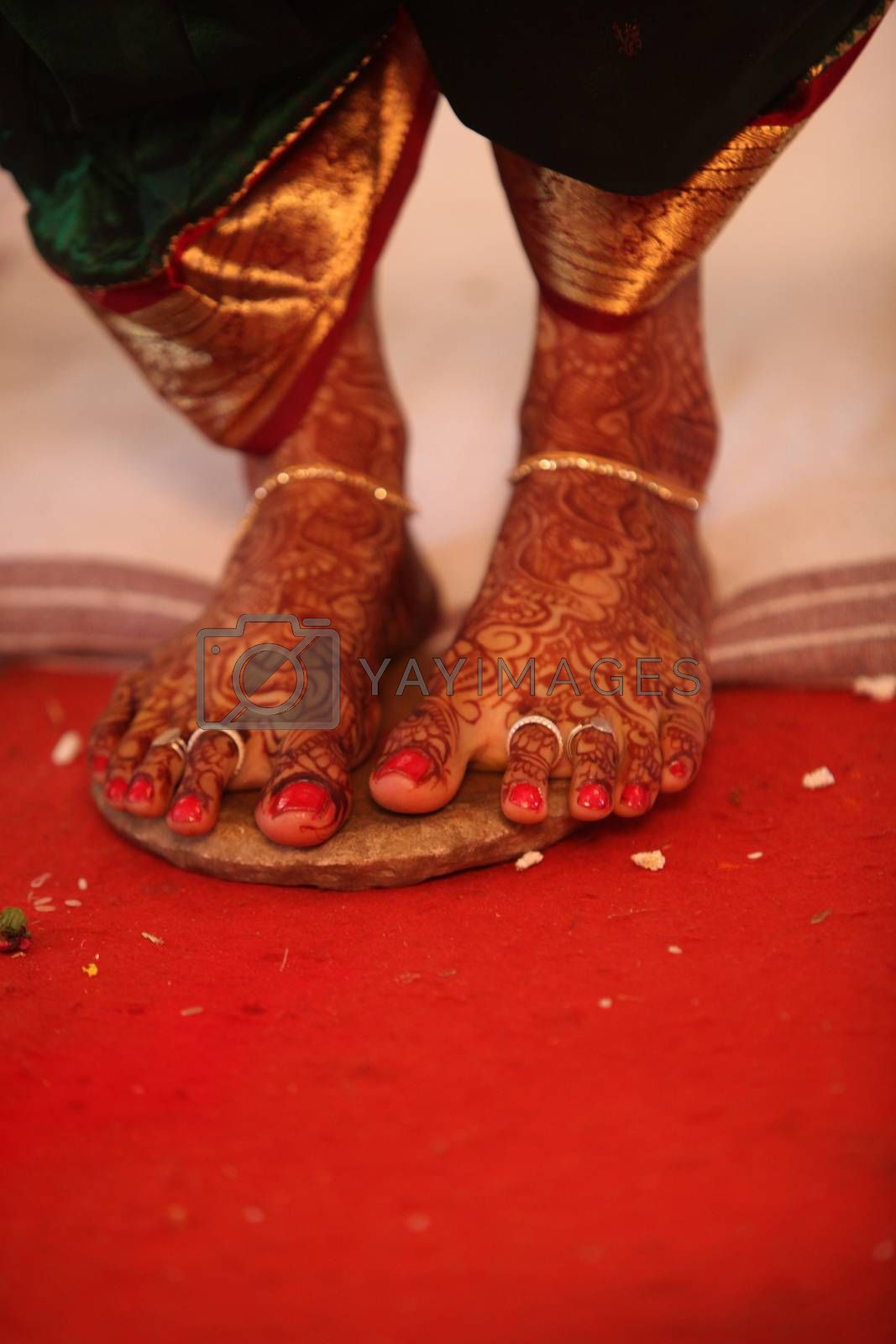 The feet of an Indian bride during the ritual in a traditional Hindu wedding.