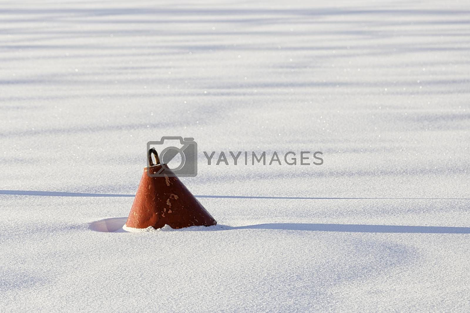 Red Buoy in frozen Water with snow.