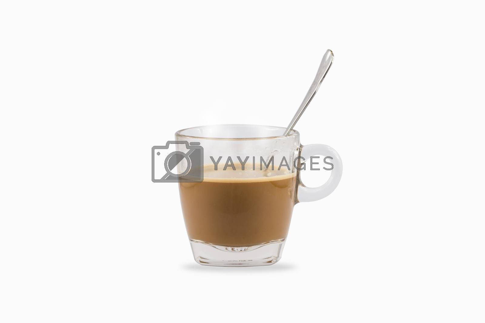 Hot coffee with teaspoon in clear glass cup isolated on white background.