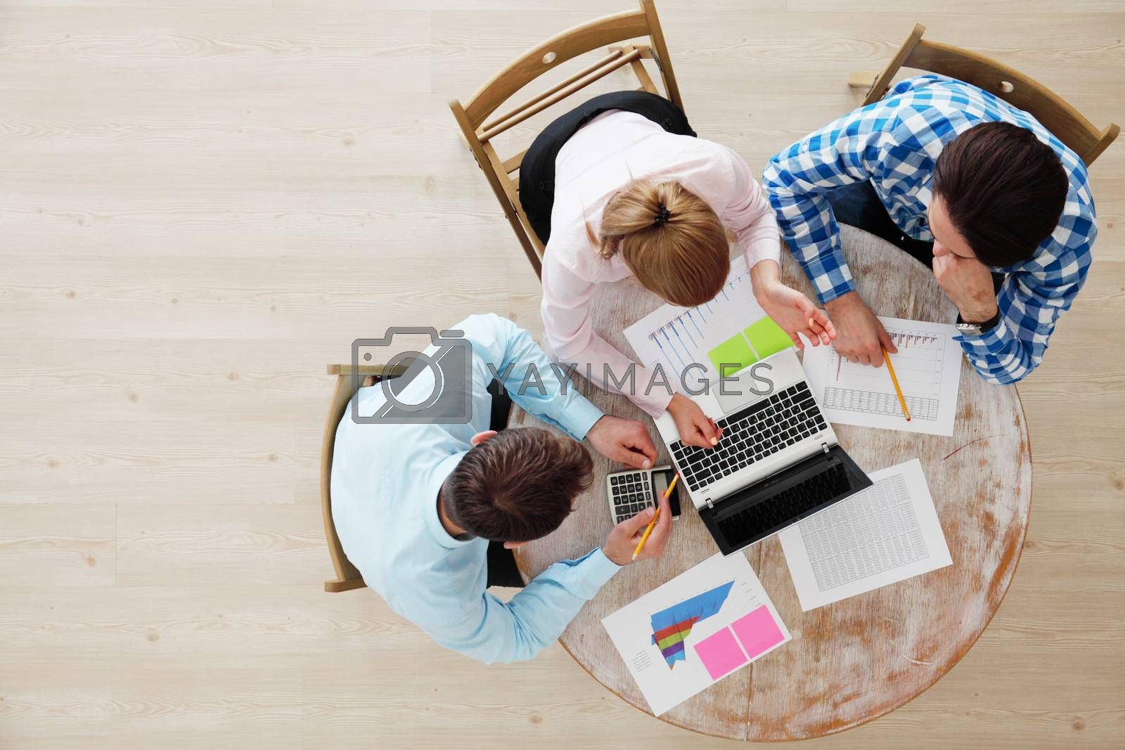People in casual clothes working with financial reports, top view
