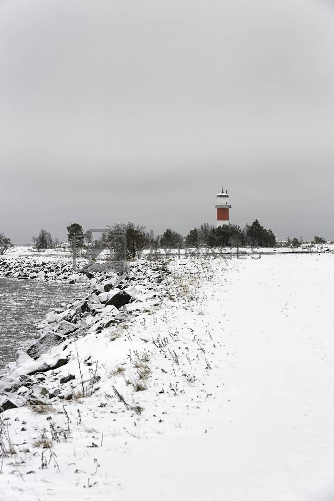 Light House with Icy Ocean and a cloudy sky.
