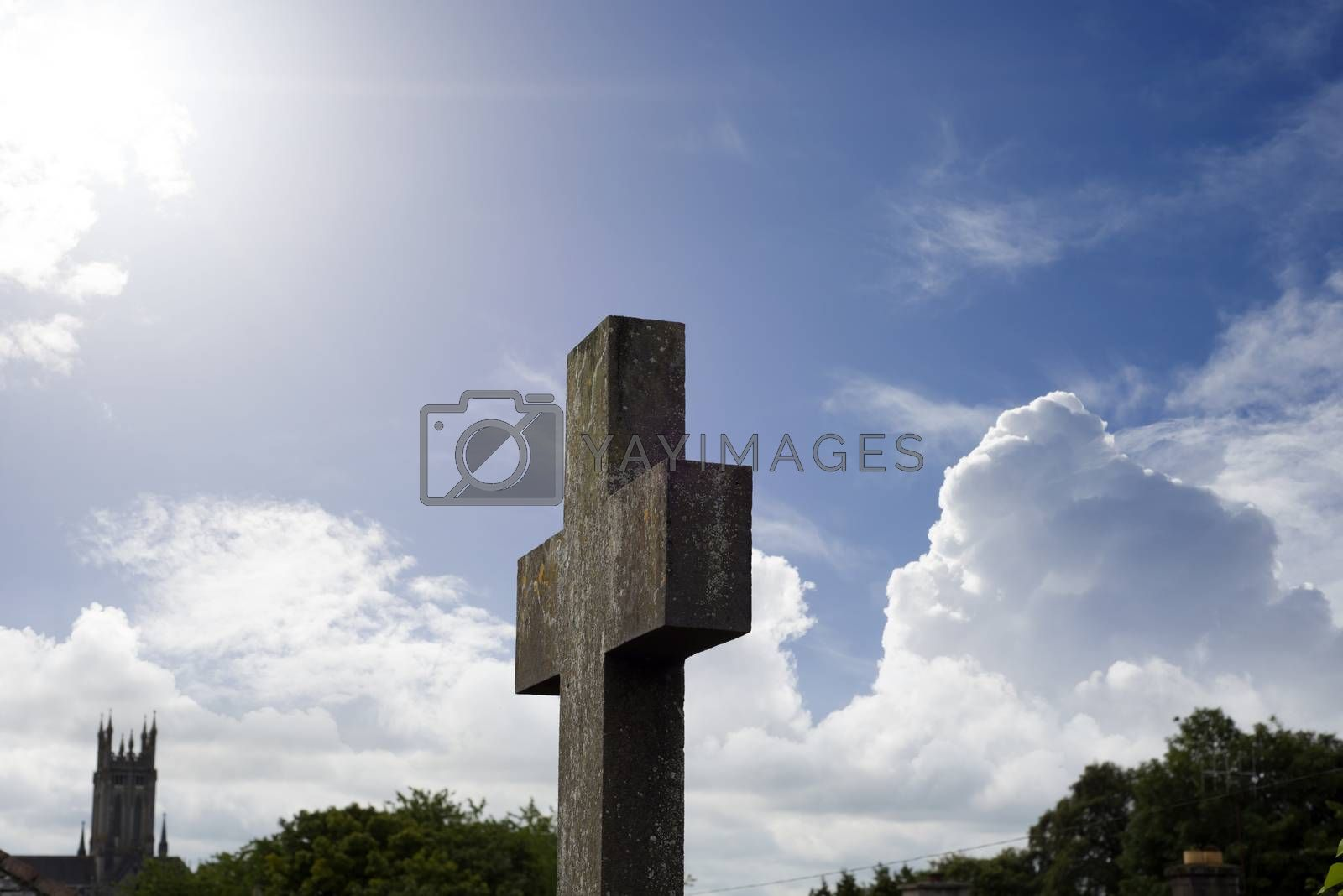 sunshine over cross at ancient graveyard in St Canice's Cathedral in kilkenny city ireland