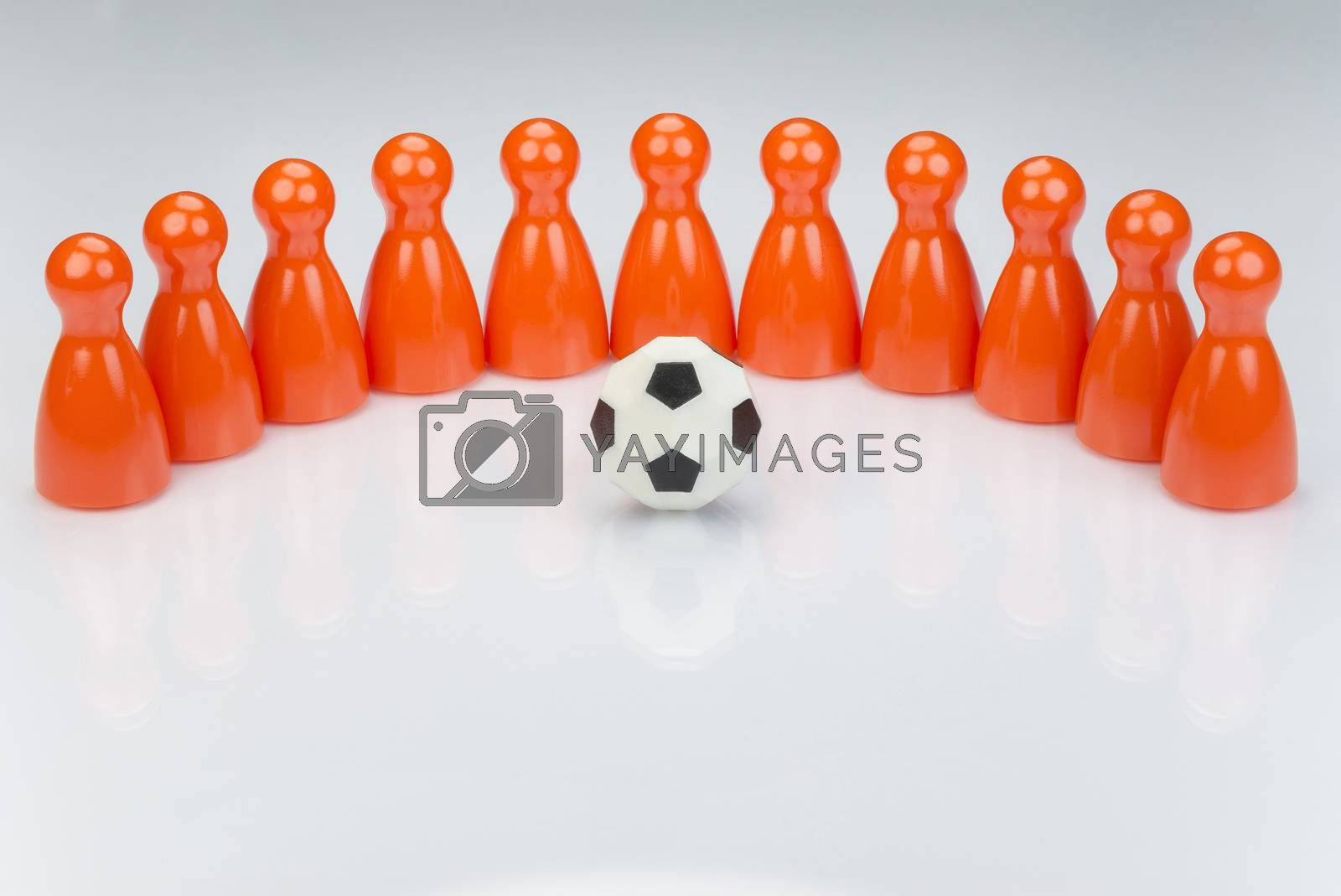 Conceptual orange game pawns as abstract view of a national football team