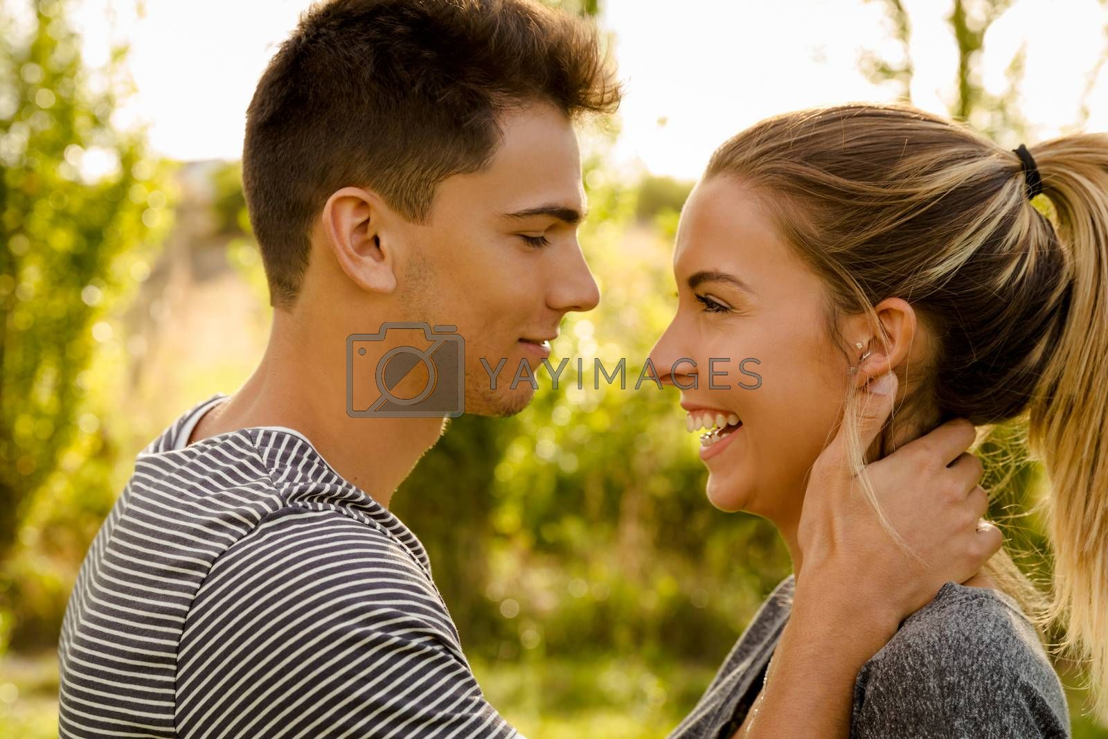 Portrait of a happy young couple in love and giving a kiss