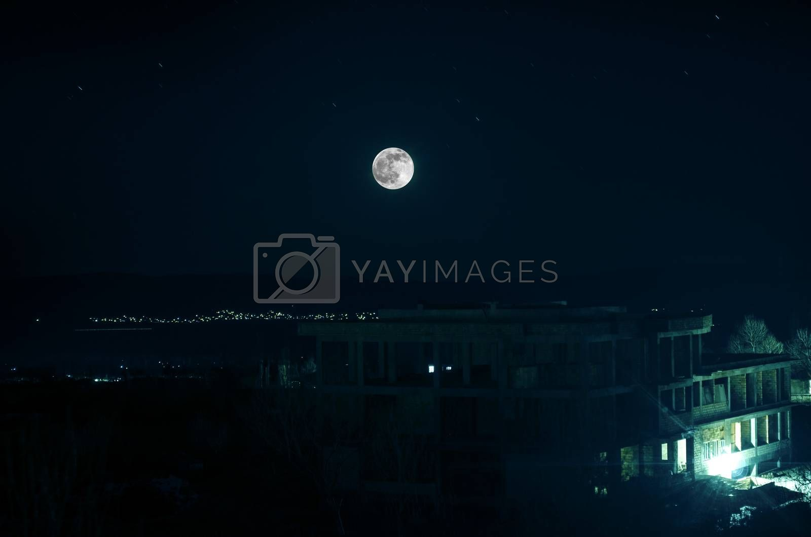Landscape of big full moon over field. Check my profile for other night landscapes