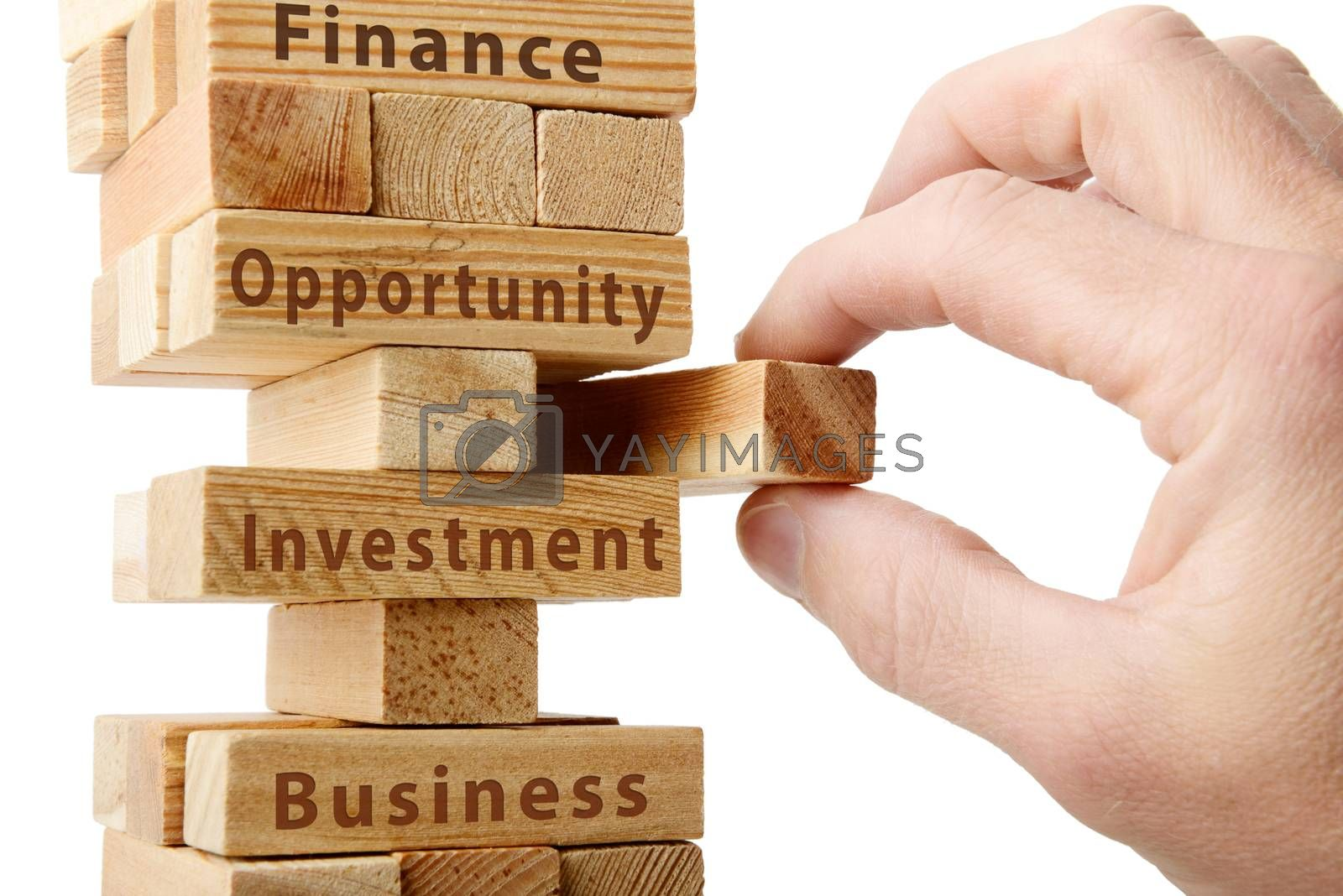 hand removing a block concept of pieces of a business isolated on a white background