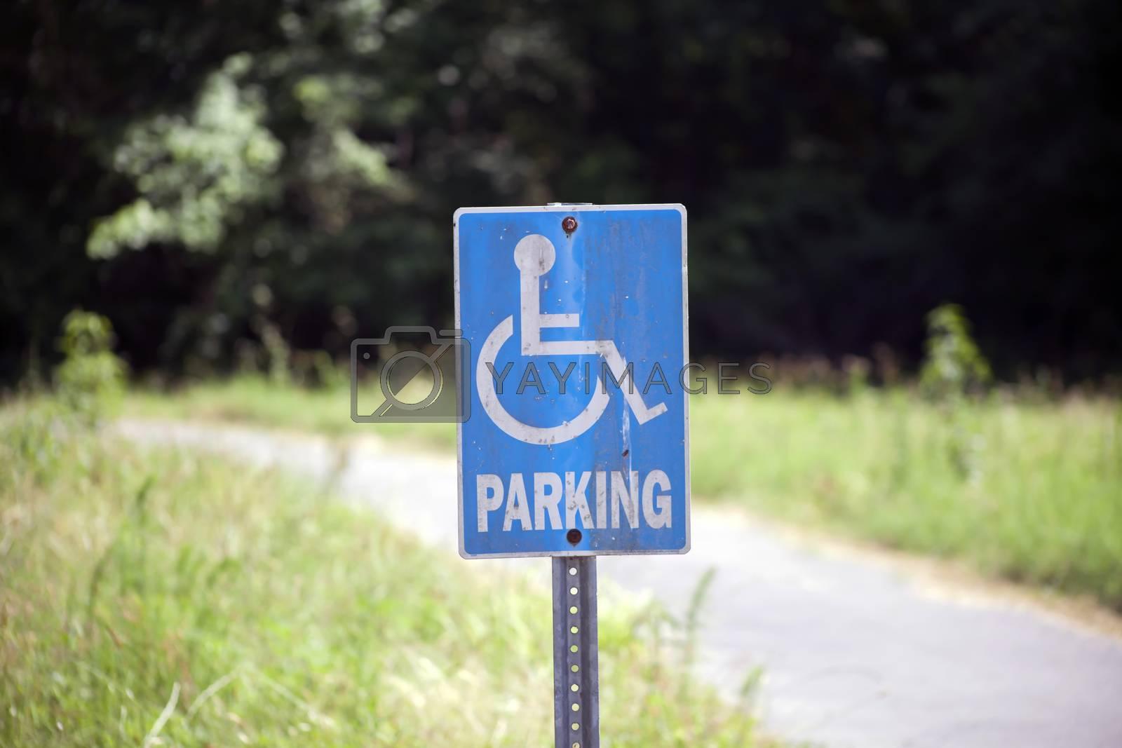 Close up of a blue accessible handicap parking sign