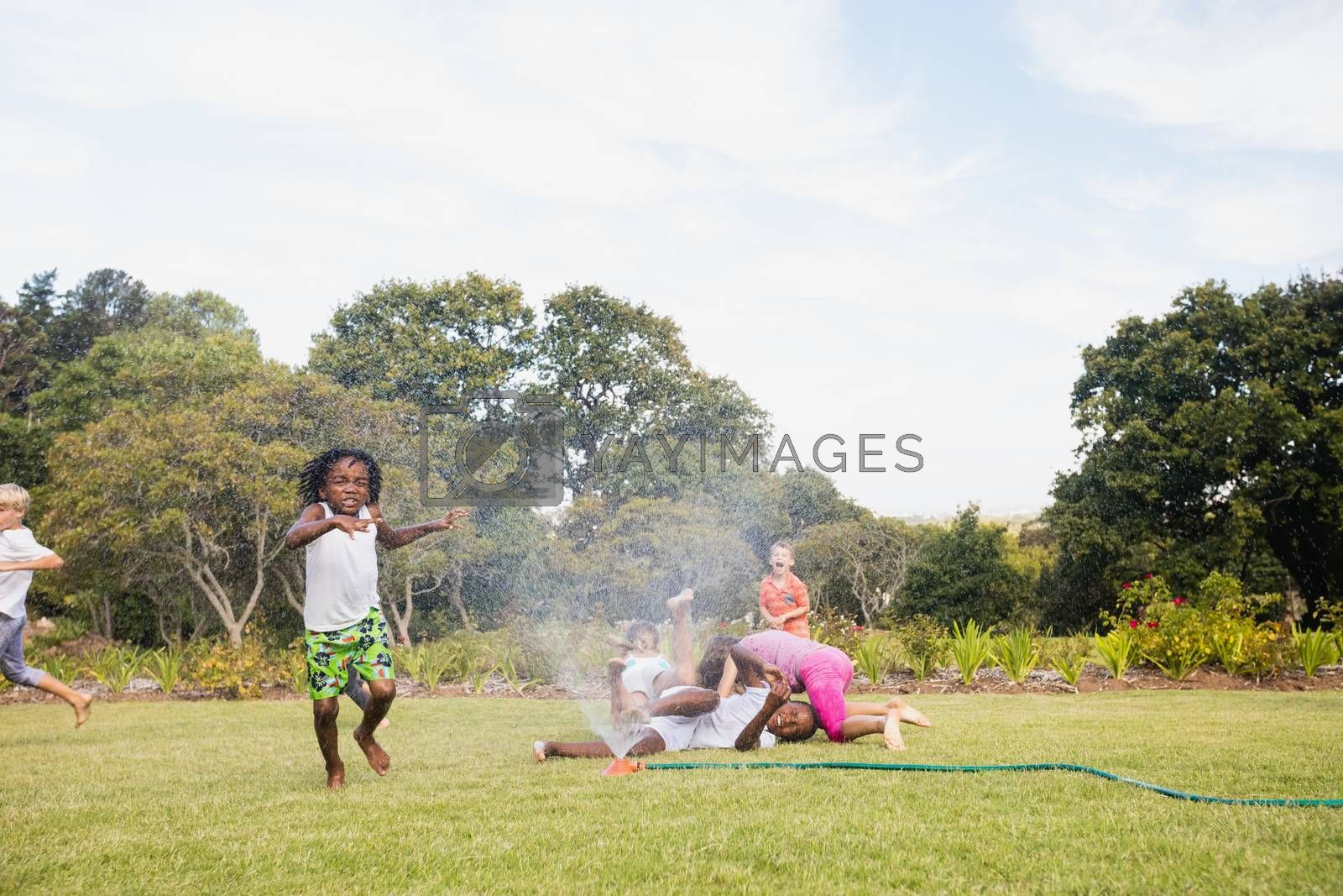 Royalty free image of Kids playing together during a sunny day by Wavebreakmedia