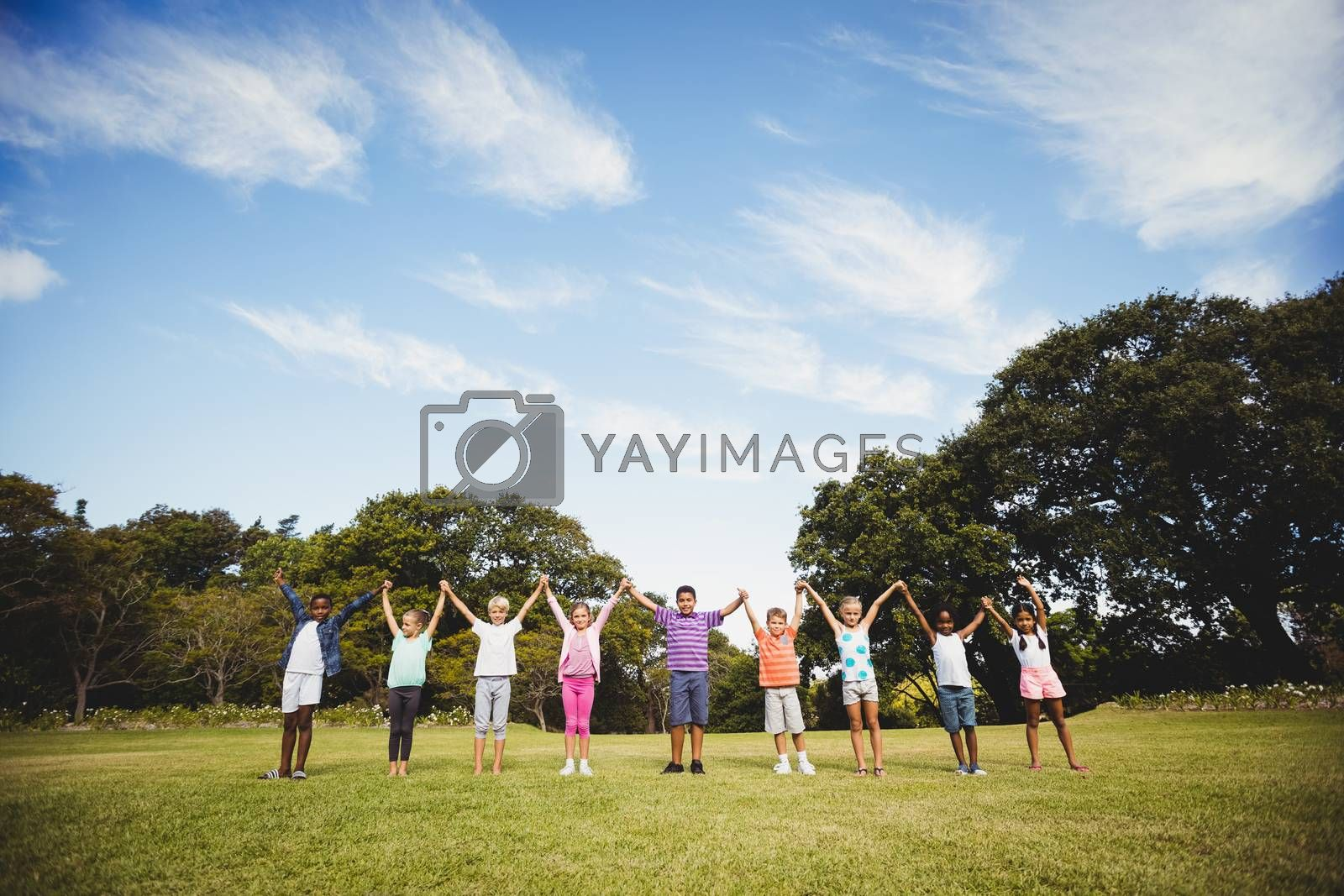Royalty free image of Smiling kids posing together during a sunny day by Wavebreakmedia