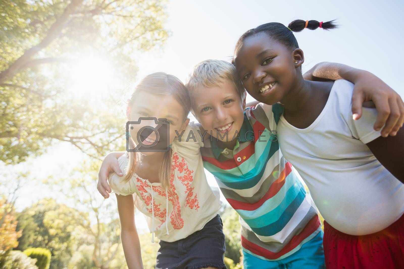 Kids posing together during a sunny day at camera at park