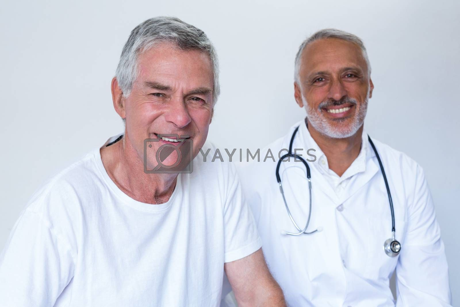 Royalty free image of Portrait of happy male doctor and senior man by Wavebreakmedia